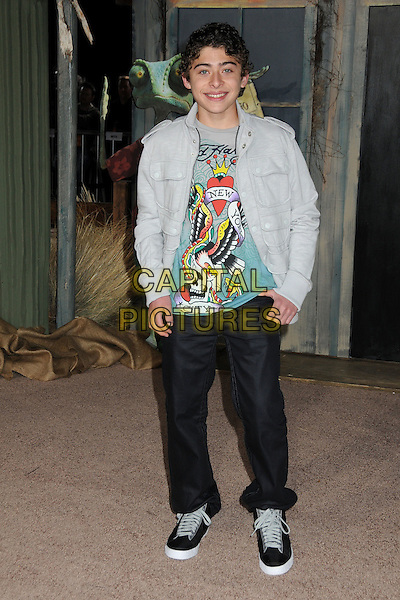"RYAN OCHOA.The L.A. Premiere of ""Rango"" held at The Regency Village Theatre in Westwood, California, USA, .February 14th 2011.full length top t-shirt jeans denim trainers grey gray .CAP/ADM/BP.©Byron Purvis/AdMedia/Capital Pictures."
