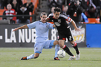 D.C. United midfielder Danny Cruz (2) gets tackle by Sporting Kansas City midfielder Graham Zusi (8) Sporting Kansas City defeated D.C. United  1-0 at RFK Stadium, Saturday March 10, 2012.