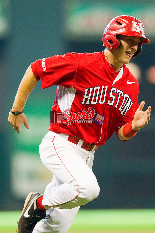 Landon Appling #1 of the Houston Cougars rounds third base to score a run in the top of the first inning against the Kentucky Wildcats at Minute Maid Park on March 5, 2011 in Houston, Texas.  Photo by Brian Westerholt / Four Seam Images