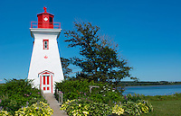Canada Prince Edward Island, P.E.I. Victoria beautiful old Lighthouse called Victoria Seaport Lighthouse or Souris East Lighthouse 1879 Souris East Lighthouse on water red and white