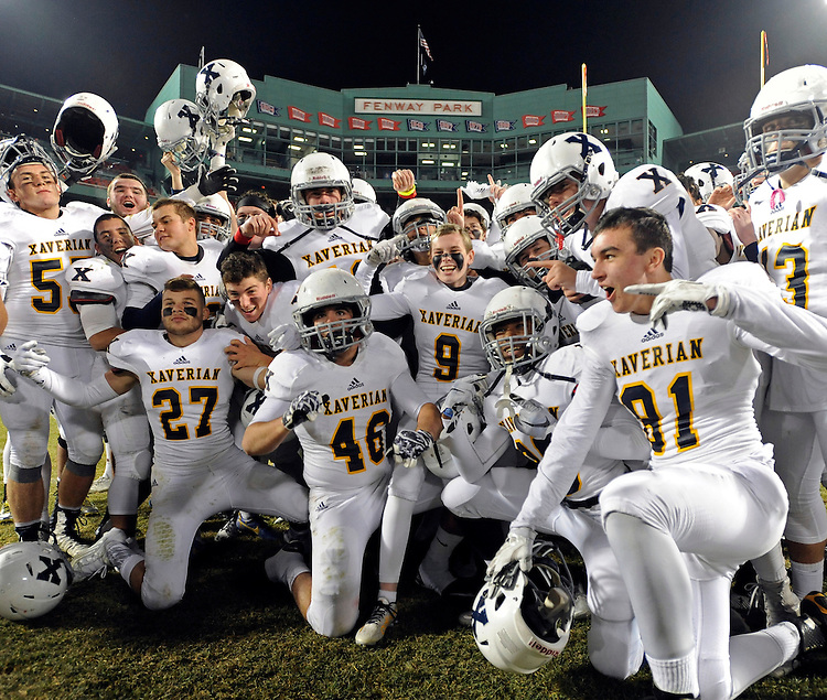 (Boston, MA) Members of the Xaverian football team celebrate their 14-0 win over St. John's Prep at Fenway Park in Boston on Wednesday, November 25, 2015. Photo by Christopher Evans