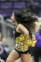 SEATTLE, WA - DECEMBER 18: Washington cheerleader Maggie Clarke entertained fans during a timeout against Savannah State.  Washington won 87-36 over Savannah State at Alaska Airlines Arena in Seattle, WA.