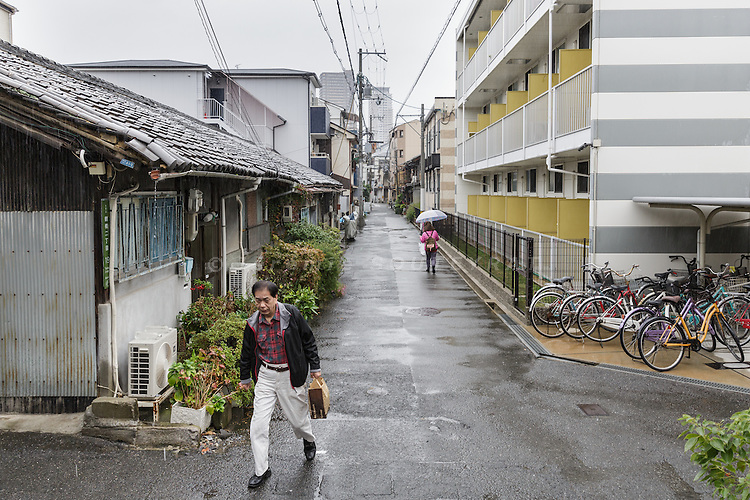 Osaka, Japan, November 25 2016 - Old houses are replaced by new building at Osaka&rsquo;s Korea town in Tsuruhashi, the home of the largest Korean community (Zainichi) in Japan.<br /> Osaka&rsquo;s Korea town in Tsuruhashi is the home of the largest Korean community (Zainichi) in Japan.<br /> The majority of Koreans in Japan are Zainichi Koreans, often known simply as Zainichi , who are the permanent ethnic Korean residents of Japan. The term &quot;Zainichi Korean&quot; refers only to long-term Korean residents of Japan who trace their roots to Korea under Japanese rule, distinguishing them from the later wave of Korean migrants who came mostly in the 1980s. The estimated population is about 500,000 people. As of 2016, about 90% of them have South Korean nationality and 10% of them are considered by Japanese administration as &laquo;&nbsp;Korean&nbsp;&raquo; (chosenjin), the word used for korean people before the division between North and South Korea in 1948. The ratio used to be the opposite in the 1950ies.