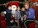 Oisín, Méabh, Ronan Harty with their big sister Ellen visiting Santa at the Laurence Centre.