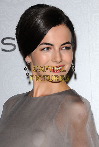 "CAMILLA BELLE.Art of Elysium 3rd Annual Black Tie charity gala '""Heaven"" held at 990 Wilshire Blvd in Beverly Hills, California, USA, .January 16th 2010 .headshot portrait hair up earrings dangling make-up grey gray beige greige sheer see thru through mesh pink lipstick .CAP/RKE/DVS .©DVS/RockinExposures/Capital Pictures"