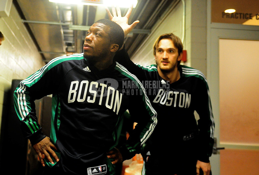 Jan. 28, 2011; Phoenix, AZ, USA; Boston Celtics guard Nate Robinson (left) and Semih Erden prior to the game against the Phoenix Suns at the US Airways Center. Mandatory Credit: Mark J. Rebilas-
