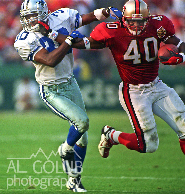 San Francisco 49ers vs. Dallas Cowboys at Candlestick Park Sunday, November 10, 1996.  Cowboys beat 49ers  20-17.  San Francisco 49ers full back William Floyd (40) stiff-arms Dallas Cowboys defensive back George Teague (30) in the face.