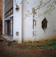 The grand entrance to the Melnikov residence, now sadly decayed by time and circumstance, showing one of the unusual hexagonal windows