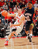 Ohio State Buckeyes guard Aaron Craft (4) drives past Morgan State Bears guard Blake Bozeman (22) during the 1st half of their game at The Value City Arena at the Jerome Schottenstein Center on November 9, 2013.  (Dispatch photo by Kyle Robertson)