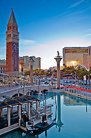 Looking across the reflective water at the Venetian in Las Vegas as the sun sets