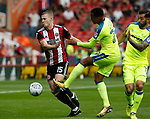Paul Coutts of Sheffield Utd tussles with Marcus Olsson of Derby County during the Championship match at Bramall Lane, Sheffield. Picture date 26th August 2017. Picture credit should read: Simon Bellis/Sportimage