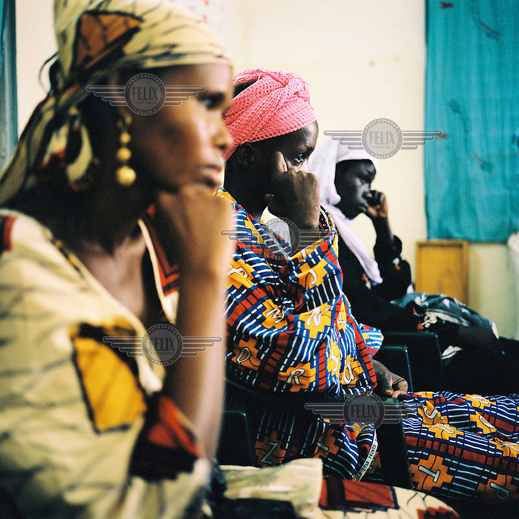 AIDS patients recently diagnosed have a discussion with health workers from the Centre for Treatment, Activities and Counselling for People living with HIV/AIDS (CESAC), which is the main organisation working with AIDS patients in Mali.