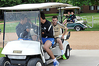 Prior to playing Manchester City in a friendly game at Busch Stadium, home of the St Louis Cardinals baseball team, Chelsea held a closed practice at Robert R Hermann Stadium on the campus of Saint Louis University..Juan Mata is driven to the field on a golf cart by members of the Saint Louis University soccer team.
