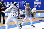 DURHAM, NC - FEBRUARY 25: Duke's Lee Kiefer (right) attacks Duke's Julia Lee (left) during their Women's Foil semifinal match. The Atlantic Coast Conference Fencing Championships were held on February, 25, 2017, at Cameron Indoor Stadium in Durham, NC.