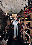 A wine enthusiast in his Bucks County Pennsylvania wine cellar that is believed to have served as part of the Underground Railroad during the civil war.
