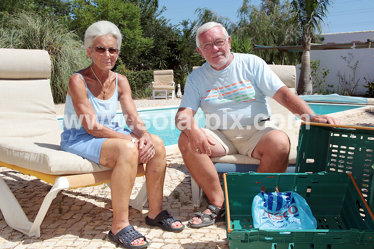 **ALL ROUND EXCLUSIVE PICTURES FROM SOLARPIX.COM**.**WORLDWIDE SYNDICATION RIGHTS**.British Expats Professor Colin New, 64, and wife Roberta, 65 at their Villa on the Algarve in Portugal..Re Tesco delivery for expats story..This pic: Professor Colin New & wife Roberta..JOB REF: 9596        SSS       DATE:23.07.09.**MUST CREDIT SOLARPIX.COM OR DOUBLE FEE WILL BE CHARGED**.**MUST AGREE FEE BEFORE ONLINE USAGE**.**CALL US ON: +34 952 811 768 or LOW RATE FROM UK 0844 617 7637**