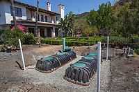 Water capture by installing cisterns for roof runoff in water conserving Southern California garden; design Urban Water Group