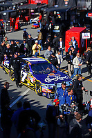 14 February, 2010, Daytona Beach, Florida USA USA.Matt Kenseth's Crown Royal Ford is pushed through the garage area to the grid..©F. Peirce Williams 2010 USA.