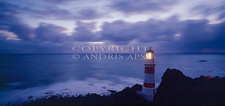 Cape Palliser lighthouse at dusk. Wairarapa area. Wellington Region. New Zealand