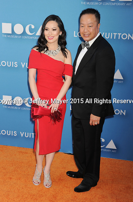 LOS ANGELES, CA - MAY 30:  Christine Chiu and Dr. Gabriel Chiu arrive at the 2015 MOCA Gala presented by Louis Vuitton at The Geffen Contemporary at MOCA on May 30, 2015 in Los Angeles, California.