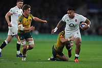 Manu Tuilagi of England is tackled by Tolu Latu of Australia as Michael Hooper (c) of Australia joins the action during the Quilter International match between England and Australia at Twickenham Stadium on Saturday 24th November 2018 (Photo by Rob Munro/Stewart Communications)