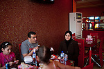 A family eats at New Popeyes restaurant on Friday, October 22, 2010 in Basrah, Iraq.