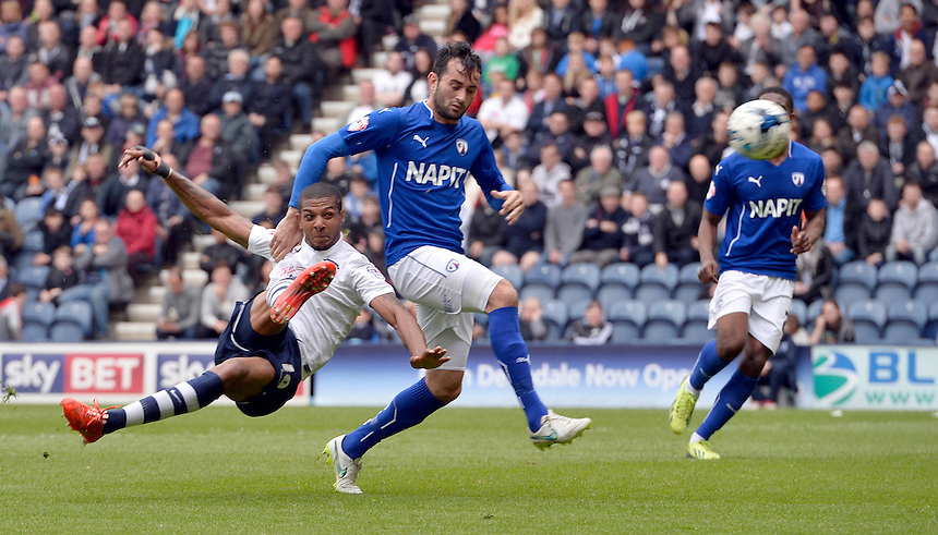 Preston North End's Jermaine Beckford beats Chesterfield's Sam Hird to the ball and scores the opening goal<br /> <br /> Photographer CameraSport<br /> <br /> Football - The Football League Sky Bet League One Semi-Final Second Leg - Preston North End -  Chesterfield - Deepdale - Preston<br /> <br /> &copy; CameraSport - 43 Linden Ave. Countesthorpe. Leicester. England. LE8 5PG - Tel: +44 (0) 116 277 4147 - admin@camerasport.com - www.camerasport.com