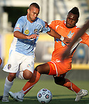 02 June 2012: Puerto Rico's Jonathan Fana (DOM) (9) is fouled by Carolina's Gale Agbossoumonde (17). The Carolina RailHawks defeated the Puerto Rico Islanders 2-1 at WakeMed Soccer Stadium in Cary, NC in a 2012 North American Soccer League (NASL) regular season game.