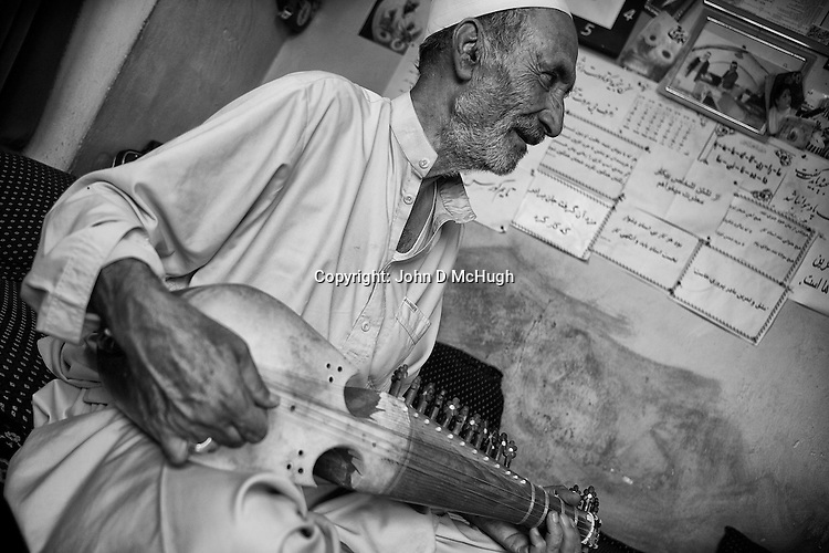 Mohammad Naim, a 70 year old rabab player, is seen in his studio in Kabul, 18 August 2012. (John D McHugh)