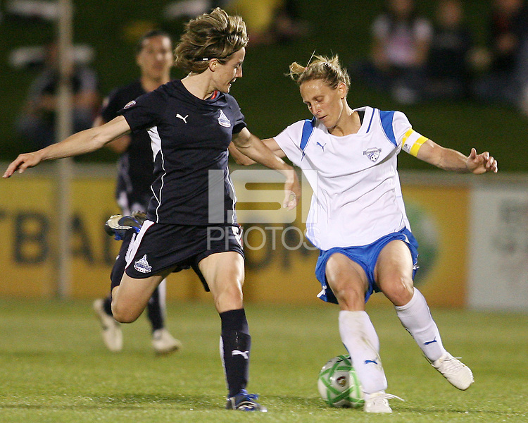 Sonia Bompastor #8 of the Washington Freedom loses the ball to Kristine Lilly #13 of the Boston Breakers during a WPS match at the Maryland Soccerplex, in Boyd's, Maryland, on April 18 2009. Breakers won the match 3-1.