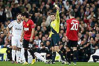 German referee Mark Borsch show the yellow card to Manchester United's Robin Van Persie (r) in presence of Shinji Kagawa (2l) and Real Madrid's Xabi Alonso during Champions League 2012/2013 match.February 12,2013. (ALTERPHOTOS/Alfaqui/Cesar Cebolla) /NortePhoto