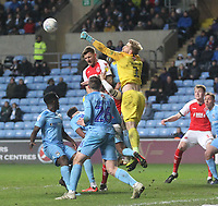 Fleetwood Town's Harry Souttarjumps with  Coventry City's Lee Burge<br /> <br /> Photographer Mick Walker/CameraSport<br /> <br /> The EFL Sky Bet League One - Coventry City v Fleetwood Town - Tuesday 12th March 2019 - Ricoh Arena - Coventry<br /> <br /> World Copyright &copy; 2019 CameraSport. All rights reserved. 43 Linden Ave. Countesthorpe. Leicester. England. LE8 5PG - Tel: +44 (0) 116 277 4147 - admin@camerasport.com - www.camerasport.com