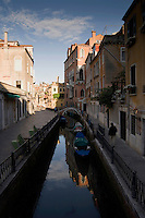 Single figure walking along the canals of Venice. Venice Italy