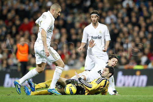 28.01.2012 SPAIN -  La Liga matchday 21th  match played between Real Madrid vs Real Zaragoza at Santiago Bernabeu stadium. The picture shows Karim Benzema (Real Madrid) Mesut Ozil (Real Madrid) and Helder Manuel Marques Postiga (Real Zaragoza)