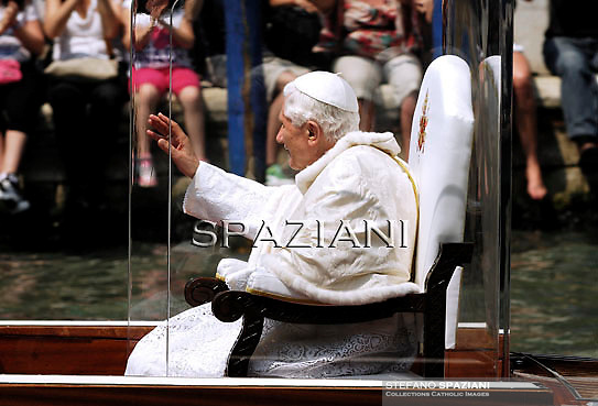 Pope Benedict XVI sits in a boat as he goes under the Rialto bridge on the Grand Canal in Venice during his pastoral visit to Aquilea and Venice on May 8, 2011.