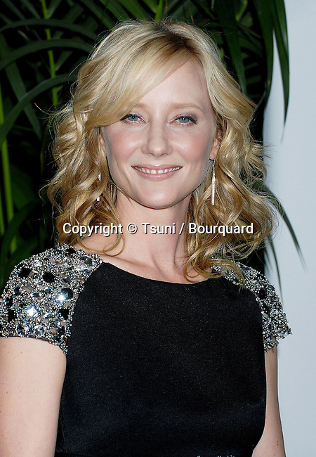 Anne Heche arriving at the tca ( television critic association ) ABC Summer party at the Beverly Hilton Hotel in Los Angeles.<br /> <br /> headshot<br /> eye contact<br /> smile