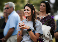 NWA Democrat-Gazette/CHARLIE KAIJO Regina Gower, volunteer for the NWA Women&Otilde;s Shelter listens to speakers during a rally, Friday, October 5, 2018 at the town square in Bentonville. Gower lost her sister to domestic violence in 2005.<br /><br />A rally was held concerning domestic violence to recognize October as Domestic Violence Awareness Month<br /><br />&quot;Of the 51 people who were killed last year, they came across from all demographics. The youngest was an infant, an unborn child. The eldest was a 74 year old woman. One victim was a nurse. Another was a day care worker, and another was a police officer responding to the domestic violence incident,&quot; said Antonella Kinder, development coordinator for the NWA Women's Shelter. &quot;All of that to say that domestic violence doesn&Otilde;t discriminate.&Oacute;