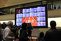 December 30, 2016, Tokyo, Japan - TV crew members video tape a share prices board after a ceremony to celebrate the last trading day of 2016 at the Tokyo Stock Exchange on Friday, December 30, 2016. Japan's share prices fell 30.77 yen to close at 19,114.37 yen at the Tokto Stock Exchange, but finished the highest close in 20 years for the last day trading of the year.  (Photo by Yoshio Tsunoda/AFLO) LWX -ytd-