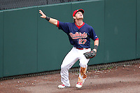 Memphis Redbirds outfielder Aaron Luna #27 tracks down a ball against the wall during a game versus the Round Rock Express at Autozone Park on April 30, 2011 in Memphis, Tennessee.  Memphis defeated Round Rock by the score of 10-7.  Photo By Mike Janes/Four Seam Images