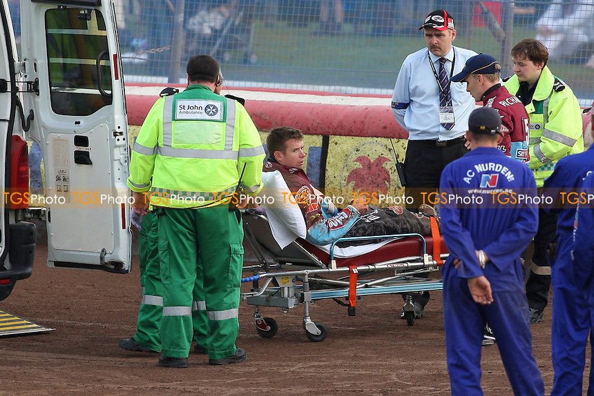 Heat 2: Stuart Robson (yellow) crashes out of the racing after tangling with Krzysztof Stojanowski and is taken to a waiting ambulance - Swindon Robins vs Lakeside Hammers - Sky Sports Elite League Speedway at Abbey Stadium - 28/05/09 - MANDATORY CREDIT: Gavin Ellis/TGSPHOTO - Self billing applies where appropriate - 0845 094 6026 - contact@tgsphoto.co.uk - NO UNPAID USE.