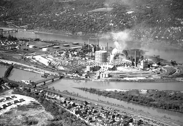 Pittsburgh PA:  Aerial view of  the Pittsburgh Coke and Chemical Plant on Neville Island.  Neville Island is not far from Pittsburgh  along the Ohio River - 1954.