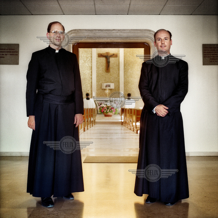 Father Andreas Schoeggl (left) stands with Father Evaristo Sada outside the chapel at the headquarters of the Legionaries of Christ in Rome. Father Andreas is the director of internal and external communication. The Legion of Christ is a conservative Roman Catholic congregation whose members take vows of chastity, obedience and poverty.