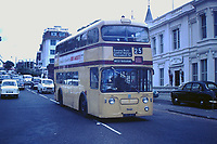 BNPS.co.uk (01202 558833)<br /> Pic: BearCrossBusCo/BNPS <br /> <br /> Back in the day - The vintage bus near Bournemouth pier in the 1960's before the roof was removed.<br /> <br /> A small group of volunteers have reintroduced a historic seaside bus service after spending five years restoring the original bus that travelled the route 50 years ago.<br /> <br /> The classic yellow open top 1965 Daimler Fleetline double decker is back running the old 'Route 12'  service between Bournemouth and Hengistbury Head.<br /> <br /> The volunteers drive and conduct the bus, as well as maintaining it and producing the timetables and bus stop flags.<br /> <br /> The vintage Bournemouth Corporation Transport bus ran along the idyllic five mile stretch of Dorset coastline from 1965 to 1977.<br /> <br /> But it had fallen into a 'sorry state' and was languishing in a depot when it was purchased by the volunteers from a bus operator in Purfleet, Essex, for £2,000 in 2014.