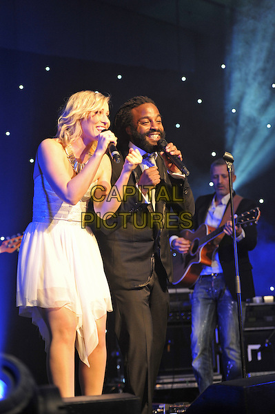 Natasha Bedingfield & John Forte.'Global Angels Awards', The Park Plaza Hotel, Westminster, London, England. 2nd December 2011..music on stage live concert gig performing half length microphone singing black suit duet white strapless dress .CAP/MAR.© Martin Harris/Capital Pictures.