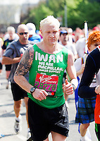 17 APR 2011 - LONDON, GBR - Former British 400m runner Iwan Thomas took part in this years London Marathon on behalf of the MacMillan charity (PHOTO (C) NIGEL FARROW)