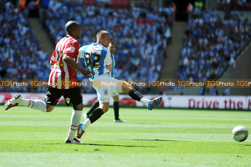Jack Hunt of Huddersfield Town has a shot on goal past Ryan Flynn of Sheffield United - Huddersfield Town vs Sheffield United - nPower League One Promotion Play-Off Final at Wembley Stadium, London - 26/05/12 - MANDATORY CREDIT: Anne-Marie Sanderson/TGSPHOTO - Self billing applies where appropriate - 0845 094 6026 - contact@tgsphoto.co.uk - NO UNPAID USE.
