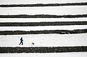 17/01/18<br /> <br /> Mark Wilkinson, walks his dog, Akira, between dry stone walls after overnight snowfall in the Derbyshire Peak District near Castleton..<br /> <br /> All Rights Reserved F Stop Press Ltd. +44 (0)1335 344240 +44 (0)7765 242650  www.fstoppress.com