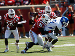 U of L's defensive line tackles junior wide reciever Randall Cobb in the first half of the UK's 23-16 win over U of L, kicking off Joker Phillip's reign as head coach on Saturday, September 5, 2010. Photo by Britney McIntosh | Staff