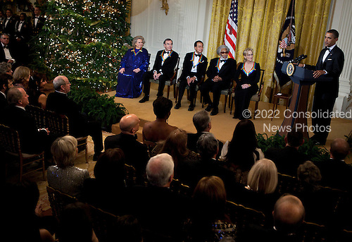 From left actress Barbara Cook, singer Neil Diamond, musician Yo-Yo Ma, musician Sonny Rollins and actress Meryl Streep listen while United States President Barack Obama speaks during a Kennedy Center Honors reception in the East Room of the White House, Sunday, December 4, 2011 in Washington, DC.  For their accomplishments and contributions to the arts actress Meryl Streep, singer Neil Diamond, actress Barbara Cook, musician Yo-Yo Ma, and musician Sonny Rollins where etched recognized as this year's recipients of the Kennedy Center Honors..Credit: Brendan Smialowski / Pool via CNP