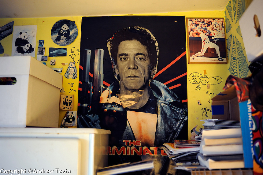 USA. Manhattan . 19th March 2009.Lou Reed's head on a Terminator poster in Jeffrey Lewis's old bedroom in his parent's apartment in the Lower East Side, Manhattan..©Andrew Testa.